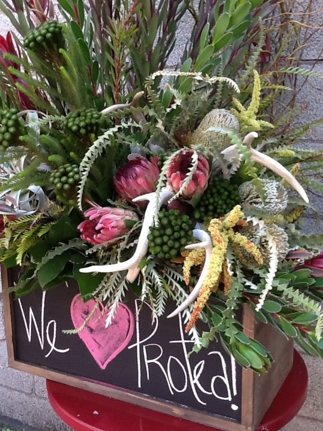 Mt Lebanon Flower Shop - Carmel designing with proteas, leucadendron, banksia and brunia from Resendiz Brothers