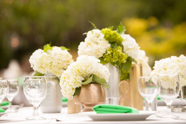 The English Garden LA - Centerpiece with gold vessels and white hydrangeas