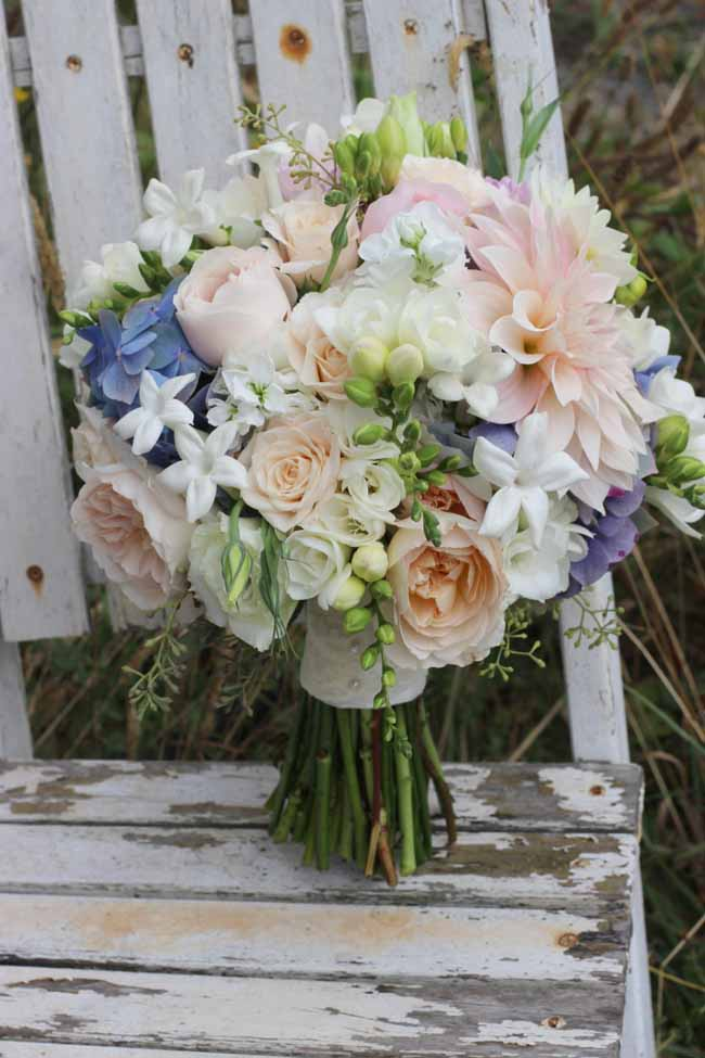romantic bridal bouquet with cafe au lait dahlias, garden roses, stephanotis, hydrangea,