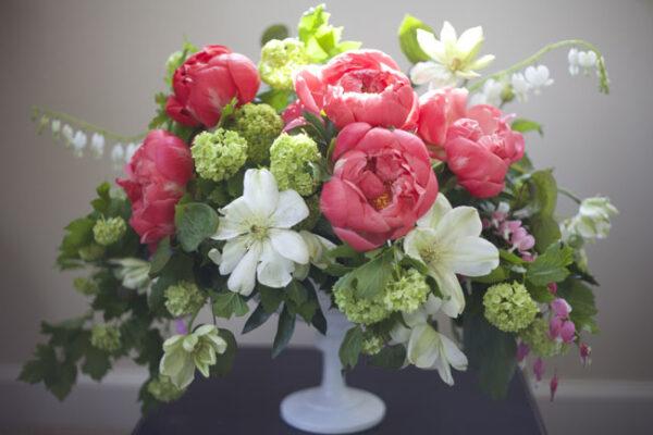 Bella Fiori - Peony, clematis and viburnum floral design in milk glass