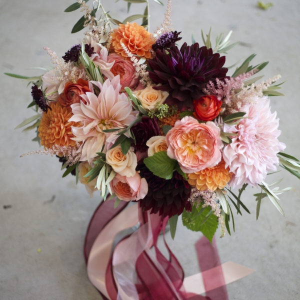 Bella Fiori in Washington. A bouquet of dahlias, garden roses, ranunculus and scabiosa flowers.