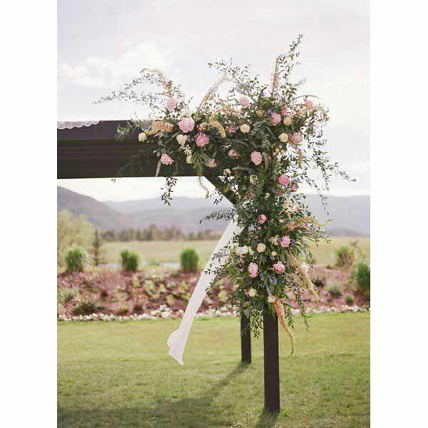 Bare Root Flora - Laura Murray Photography - Arch with Florals for wedding ceremony - Colorado
