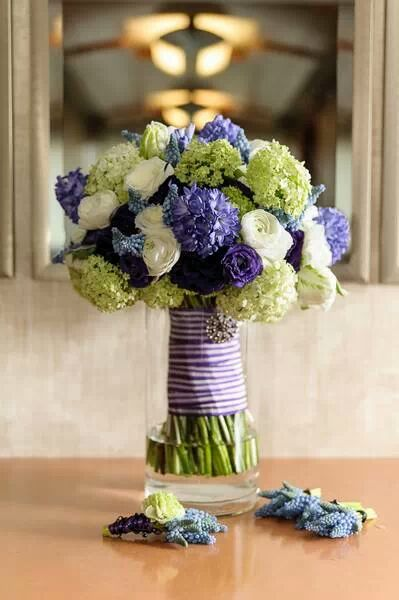 Stacey of Roots Flowers and Events - Bridal bouquet of purple and green flowers