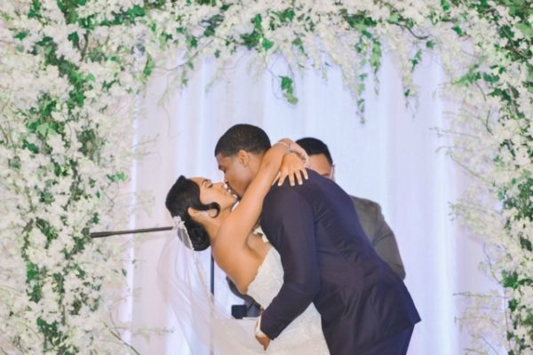 Anissa Rae Flowers & Refinements, NYC - bride and groom marry under a white flower arch