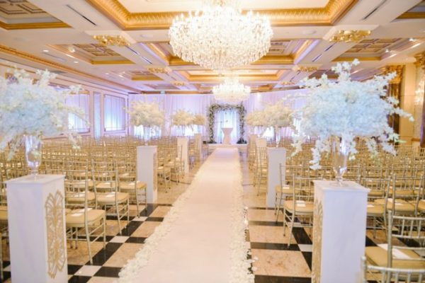 Anissa Rae Flowers & Refinements, NYC -  ceremony aisle decorated with hydrangea and white orchid flower arrangements