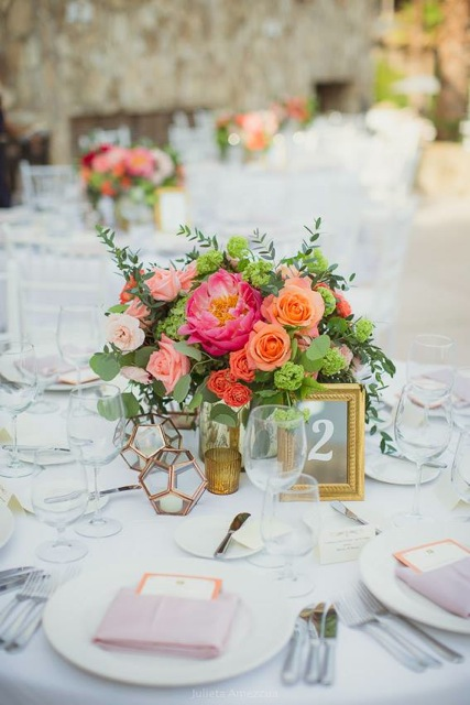 Florenta Floral Design - Centerpiece with orange and coral flowers