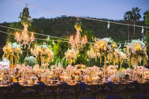 Florenta Floral Design - Sara Richardson - Wedding reception under chandeliers