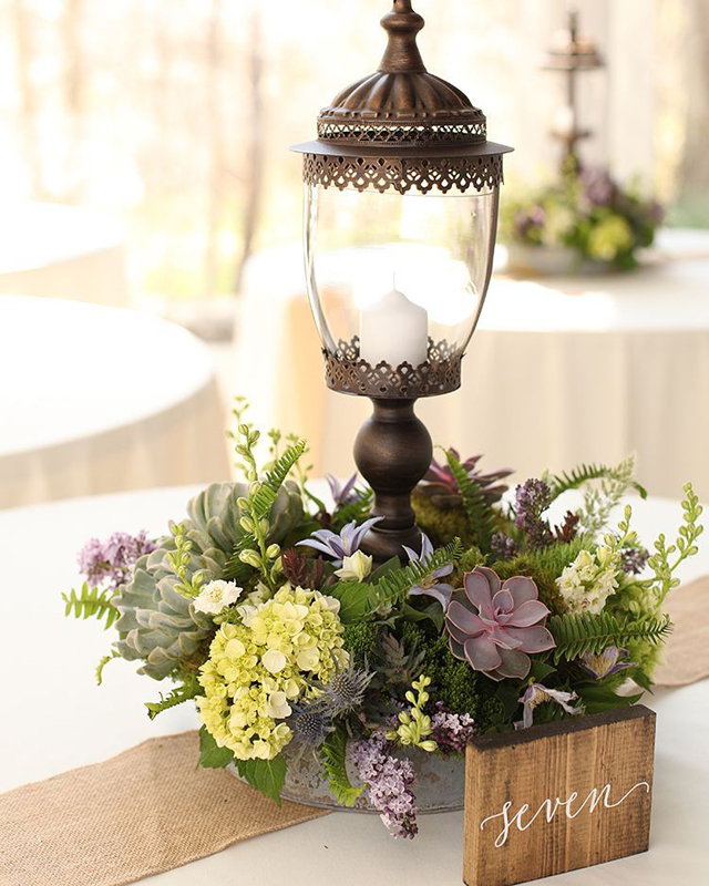 Floral Verde LLC - Cincinnati Florist -  floral centerpiece with a candle hurricane