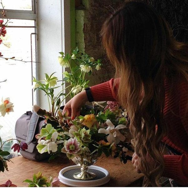 Amanda of Alluring Blooms designing an arrangement with hellebores