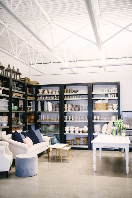 Spread Love Events + The Collection Rentals through the lens of Whitney Krutzfeldt Photography - florist shelves filled with vases and containers