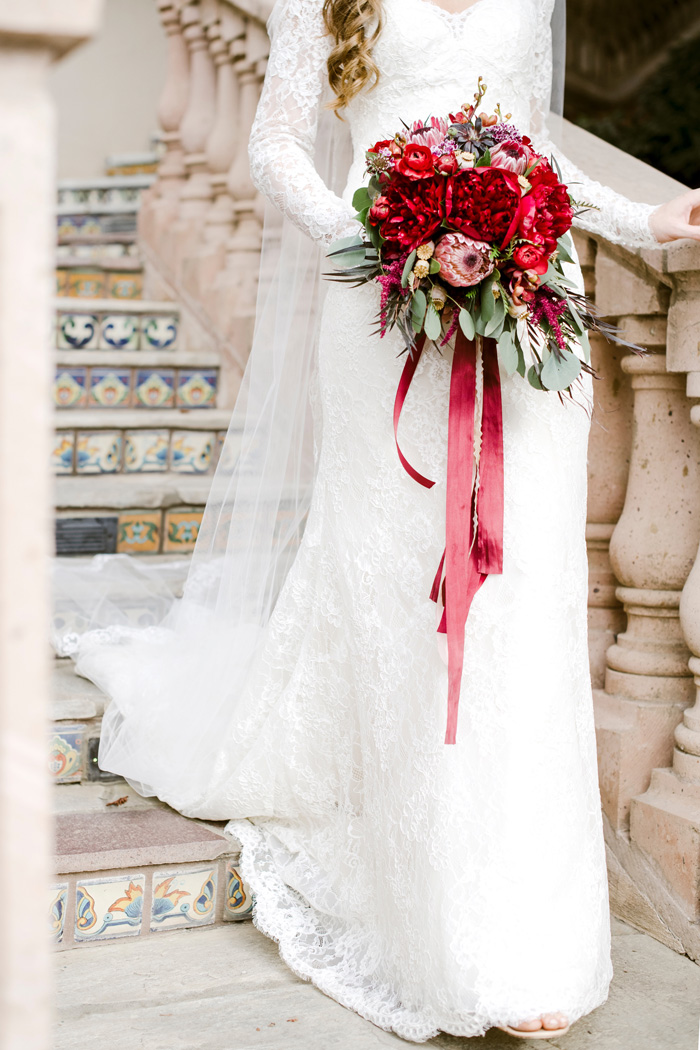 Rich red bridal bouquet designed by Fleurie Flowers in California, photographed by Ellie Koleen