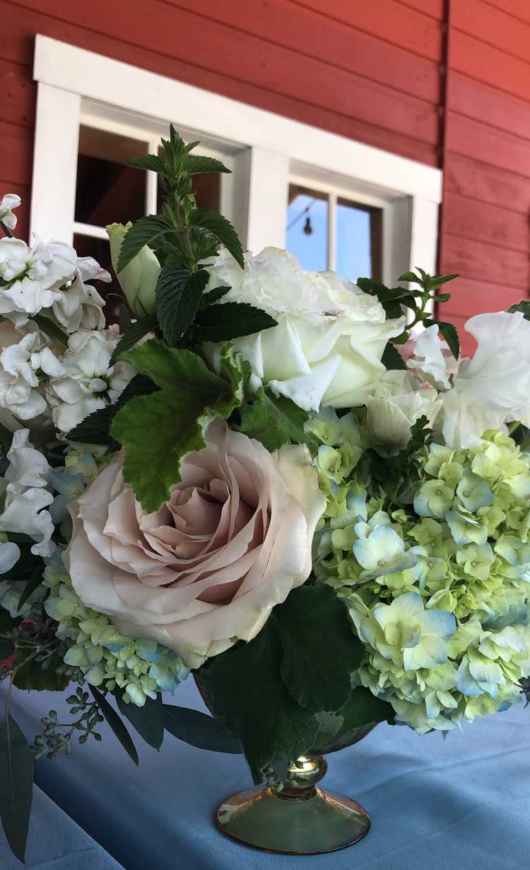 Flirty Fleurs Floral Designing, working with Deliverease to transport flowers from studio to a wedding venue