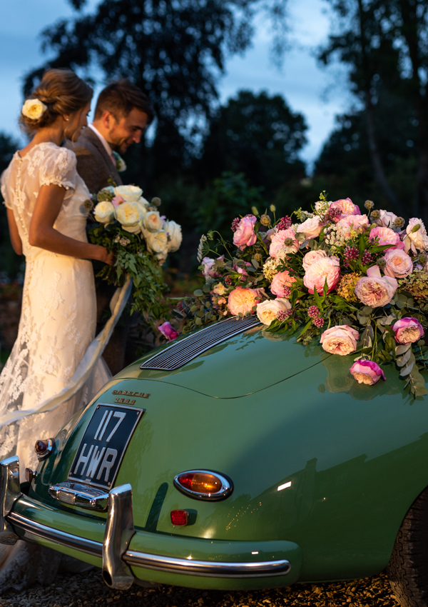The final scene ..... Dad's classic car, which he has lovingly restored in readiness for this moment – his daughter finding true love and starting a new chapter of her life. The bridal bouquet, still in her hands, has stayed close to her heart every step of the way and will always hold the special memories of this day.